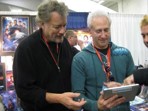 John DeLancie and Brent Spiner examine an iPad